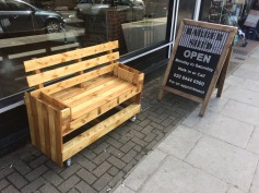 A bench in the pavement of a shop in the High street ©Pedro Redig